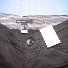 Černé bokové kalhoty Mango - foto č. 1