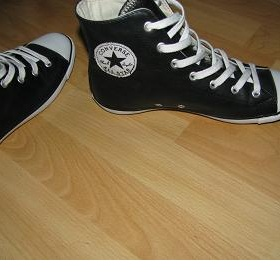 Černé kožené tenisky Converse - foto č. 1